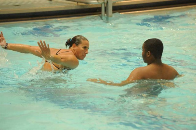 High school students learn swimming basics