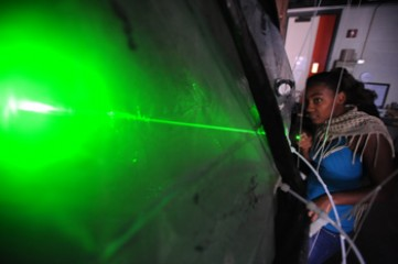 Student works with laser as part of her research